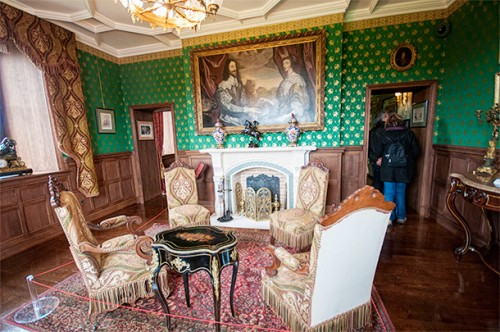 Period furniture and art are used to showcase English and French styles.