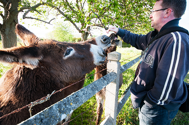 Andrew meets some friendly locals on our walk.