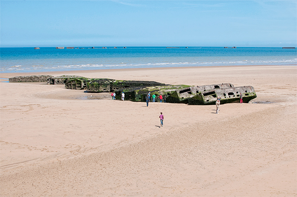 The remains of the mulberry harbour at Arromanches Beach, Normandy, France