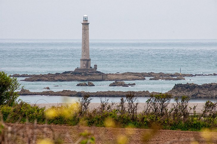 A picture-perfect view of Phare du Cap de la Hague, Normandy, France, from our motorhome windscreen